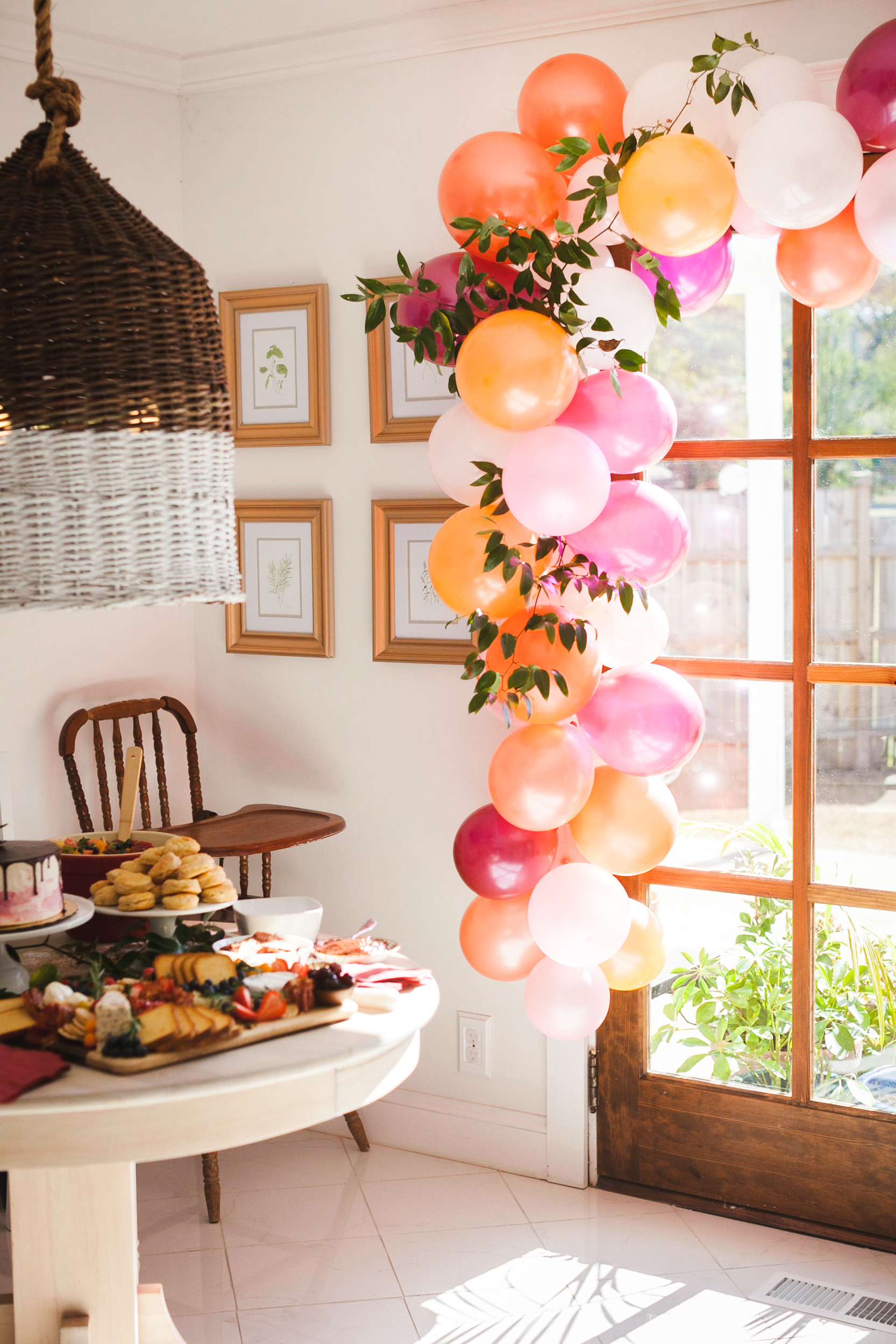 Pink and Orange Balloon Arch captured by Melissa Haithcock
