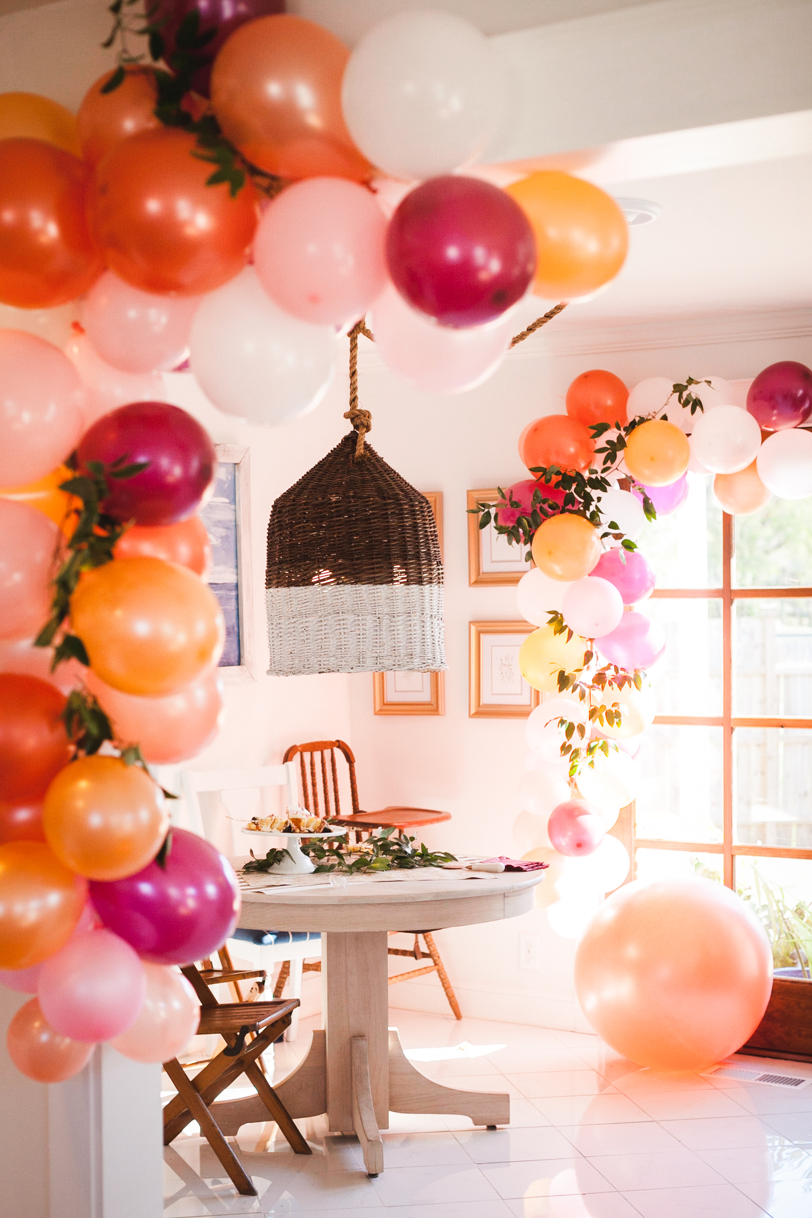 Pink, Orange, and Red Balloon Arch featured on Nashville Baby Guide