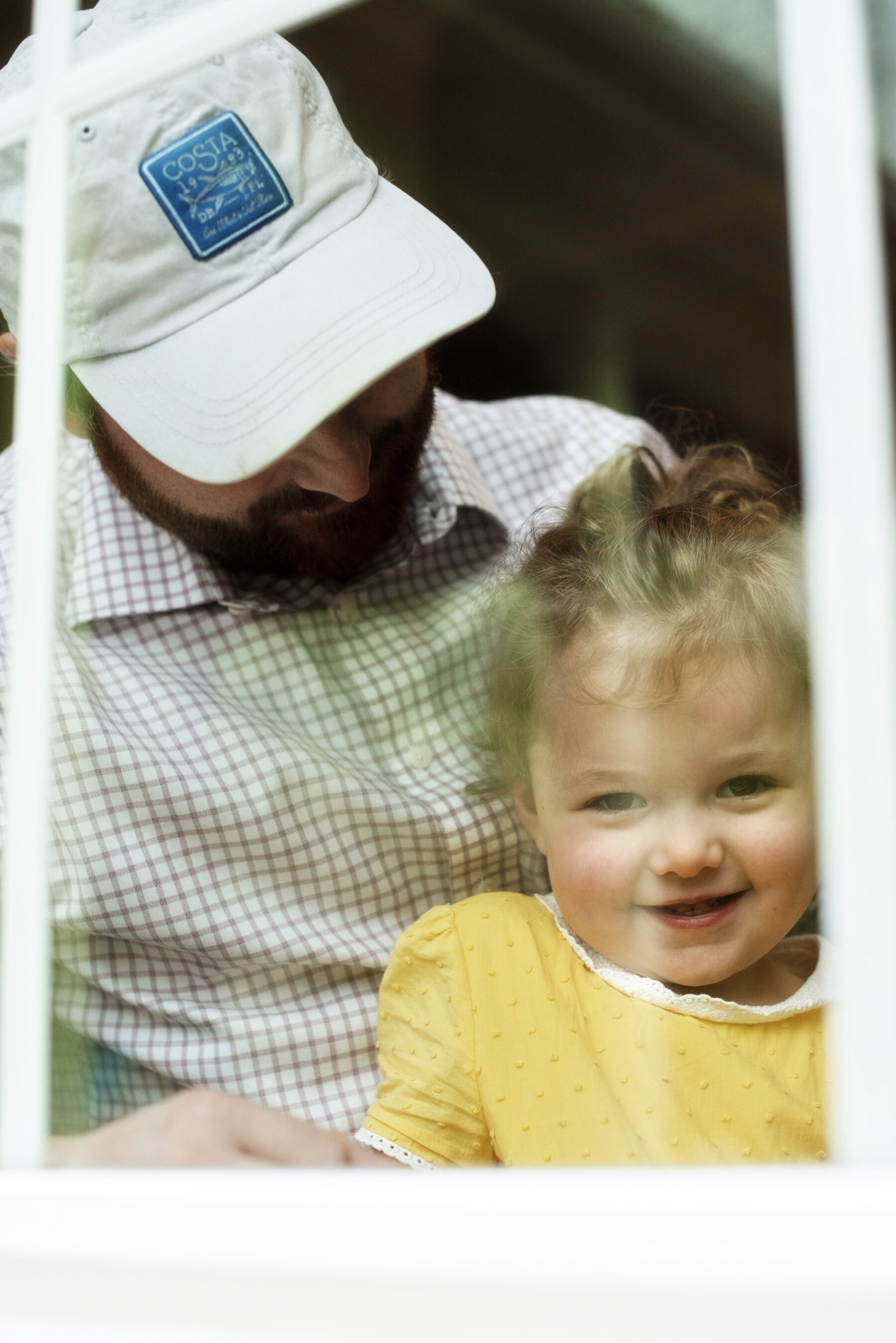 Through the window family photoshoot by Elaine Drabik Photography featured on Nashville Bride Guide