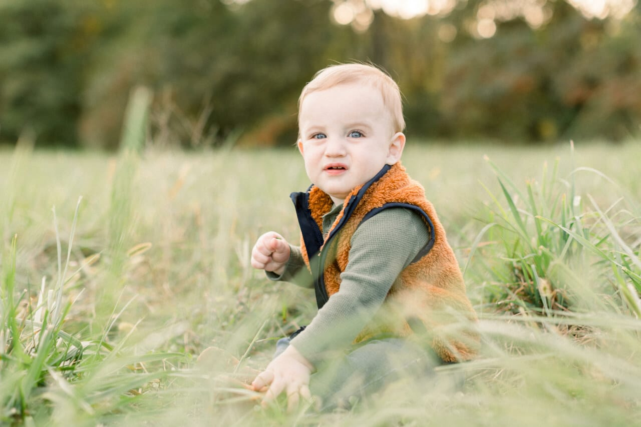 Boy sitting in the grass from j. photography featured on Nashville Bride Guide