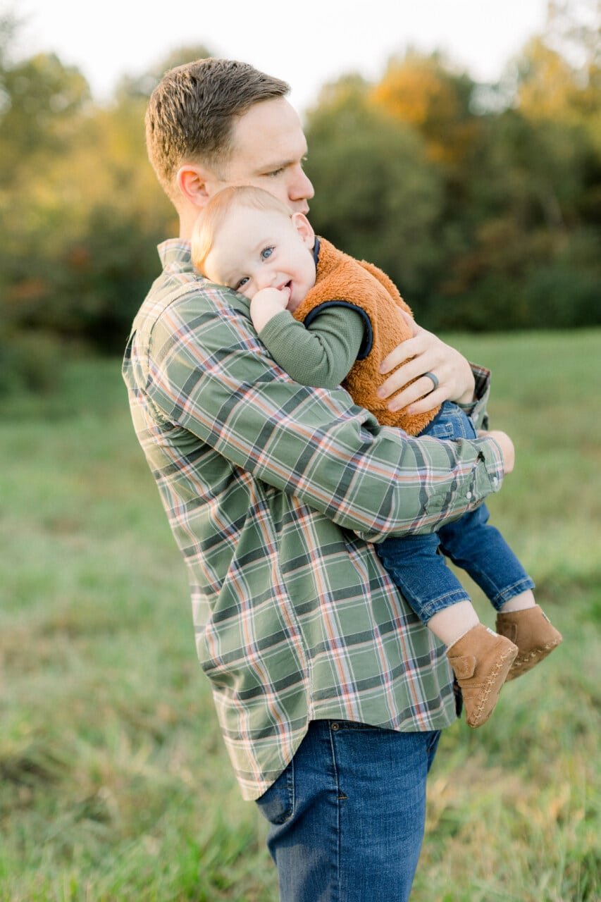Baby cuddling dad from j. photography featured on Nashville Bride Guide