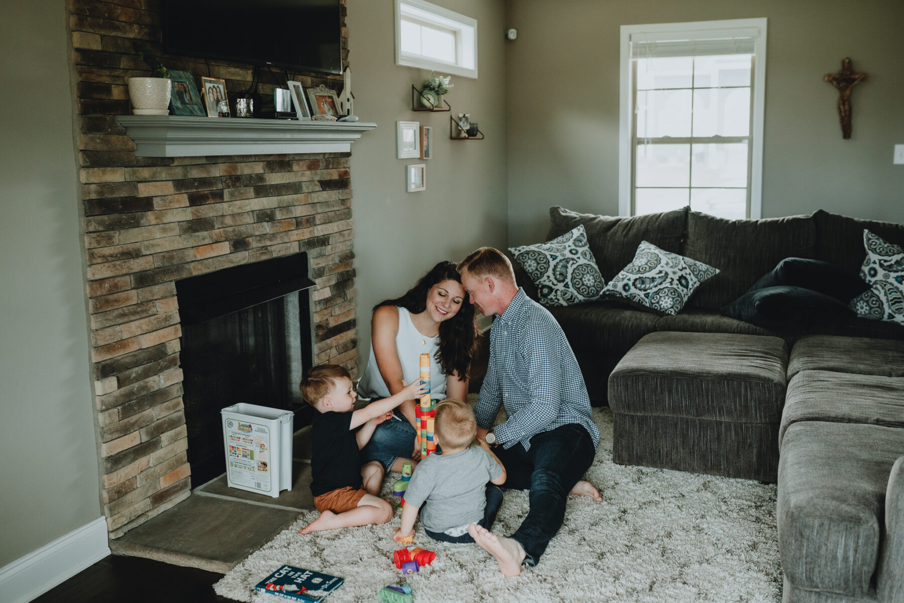 Family of four playing in their living room | Nashville Baby Guide